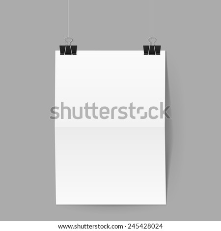 Raster version. White paper folded in half hands on black clips on grey background  - stock photo