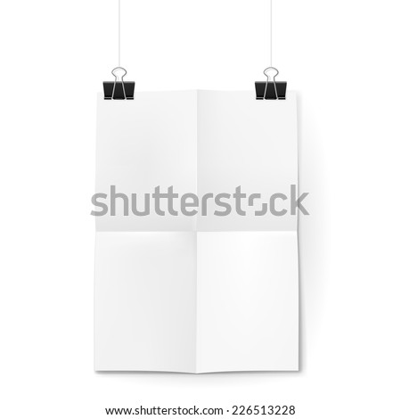 Raster version. White sheet of paper folded in four. The paper hangs on black binder clips.  - stock photo