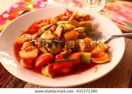 Ratatouille with spicy hot chili sauce close up photo - stock photo