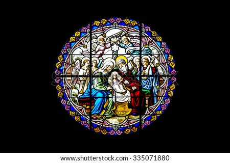 Ratchaburi - October 28: Stained glass window depicting Nativity Scene on Christmas in the cathedral of The Nativity of Our Lady, Cathedral on October, 28, 2015. - stock photo