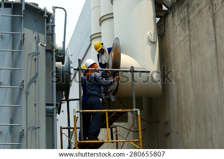 RATCHABURI -THAILAND - APRIL 22 :  The workers shift electrical equipment in pipe Gas Insulated Switchgear. (GIS), April 22, 2015 in Ratchaburi province, Thailand