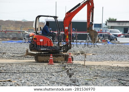RATCHABURI -THAILAND - JANUARY 7 :  A loader for construction the road in substation on January 7, 2015 in Ratchaburi province, Thailand - stock photo