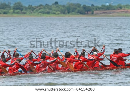 RATCHABURI,THAILAND  - SEPT 3: Traditional Thai Long Boats with a crew of 30 training before match during Queen Cup Traditional Long Boat Race Championship on Sept. 3, 2011 in Ratchaburi, Thailand