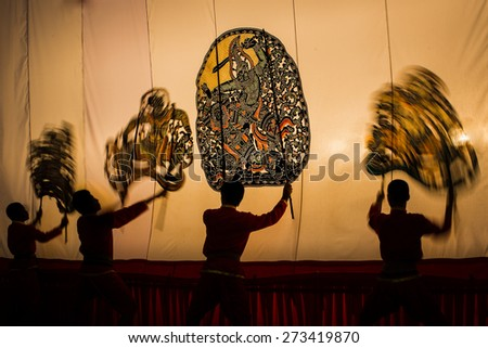 RATCHBURI, THAILAND - Marck 17: Grand Shadow Play is performed at Wat Khanon on Marck 17, 2013. The ancient performing art involves manipulating puppets of cowhide in front of a backlit white screen - stock photo