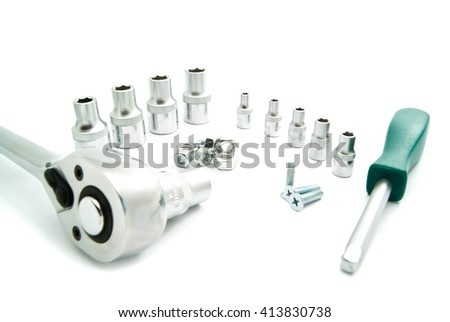 Ratchet, the various heads and bolts on white background
