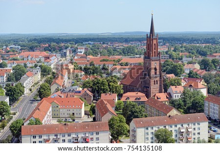 Rathenow, Brandenburg/ GERMANY August 02 2015: Aerial view over cityscape of Rathenow with its Havel river and Church. Summer time.