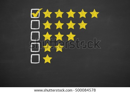 Rating Five Golden Stars on Chalkboard