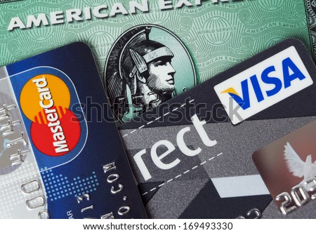 Ratingen, Germany - June 21, 2011: Closeup studio shot of  credit cards issued by the three major brands American Express, VISA and MasterCard. - stock photo