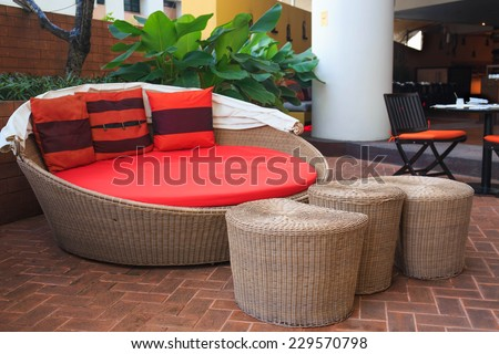 Rattan armchair furniture in garden - stock photo
