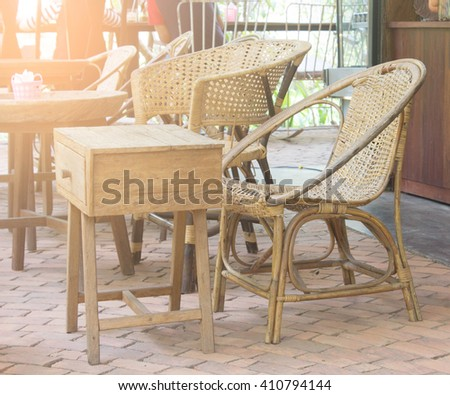 rattan chair with coffee shop background