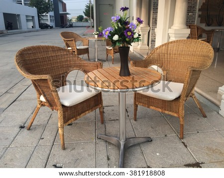Rattan chairs and wooden table  - stock photo