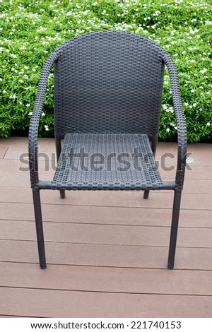 rattan furniture armchairs and table on terrace