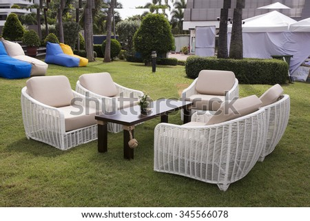 Captivating Rattan Furniture On Lawn In A Green Garden