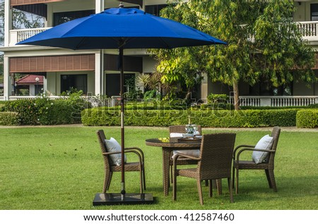 Rattan Furniture, Table, Chairs, Umbrella And Outdoor Pillows