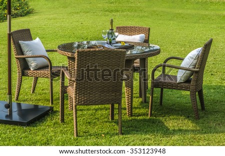 rattan garden table and chairs with water resistant outdoor pillows