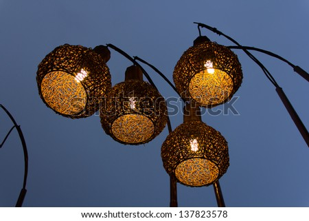 Rattan lamp in the sky - stock photo