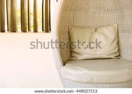 Rattan sofa seat with pillow in hotel or resort