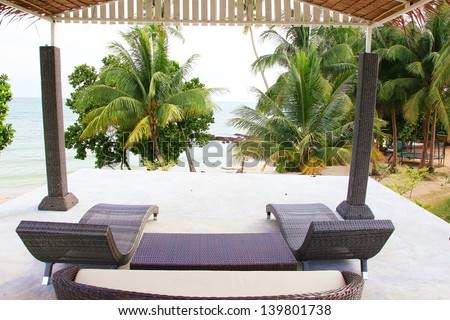 Rattan sofa with the sea view  in a luxury resort . - stock photo