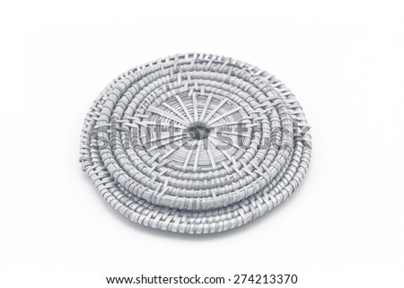 Rattan weave mat on a white background processed in tinted photo in purple tone - stock photo