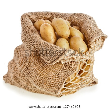 Ratte potatoes in sack bag isolated on a white background.