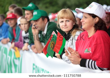 RAUBICHI, BELARUS - AUGUST 25: Spectators watch award ceremony during World Logging Championship in Raubichi, Minsk region, Belarus at August 25, 2012