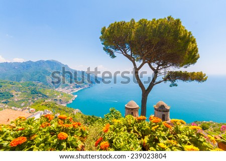 Ravello, scenic view of the Amalfi Coast from Villa Rufolo, flowers and mediterranean sea - stock photo