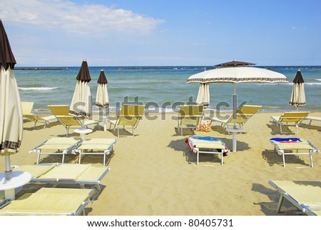 Ravenna, Adriano sand beach umbrellas and deckchairs for summer vacations