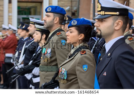 "RAVENNA, EMILIA ROMAGNA/ITALY- 04 nov 2013: Female soldier during  celebration of the ""Day of the Armed Forces and National Unity"""
