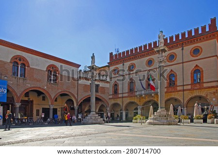 RAVENNA, ITALY-MARCH 21, 2013: tourists walking in People square. The city defined by UNESCO heritage of humanity has 3 million tourists per year. - stock photo