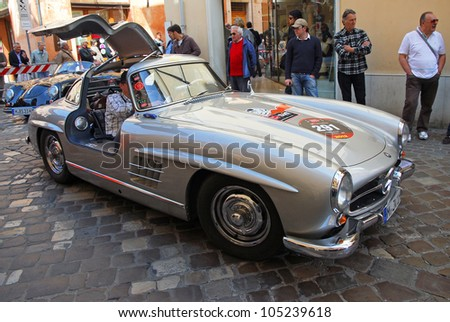 """RAVENNA, ITALY - MAY 18:  A MERCEDES-BENZ 300 SL W198-I (1955) at the """"Mille miglia"""" historical race for classic cars on May 18, 2012 in Ravenna, Italy. - stock photo"""