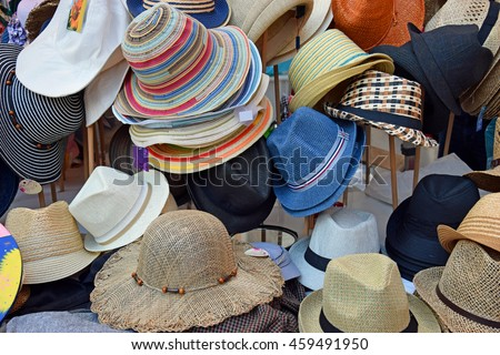RAVENNA, ITALY-MAY 15, 2016: Hats at Ravenna outdoor market. This market is very popular and attract thousands of tourists. - stock photo