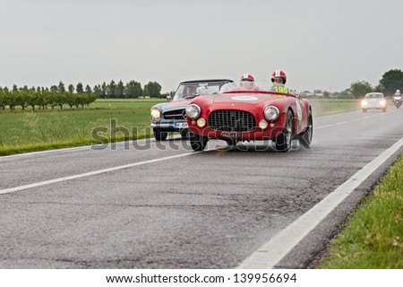 RAVENNA, ITALY - MAY 17: unidentified drivers on the old racing car Ferrari 212 export (1951) in rally Mille Miglia, the famous italian historical race (1927-1957) on May 17, 2013 in Ravenna, Italy - stock photo
