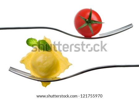 ravioli and cherry tomato on a fork with basil garnish against white background - stock photo