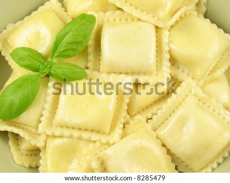 Ravioli pasta filled with ricotta, parmesan, and romano cheeses. - stock photo