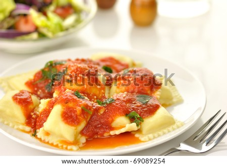 Ravioli pasta with red tomato sauce - stock photo