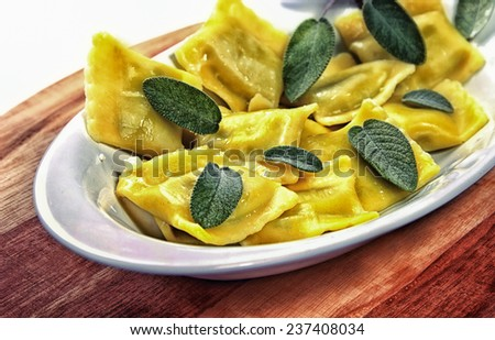 Ravioli with butter and sage - stock photo