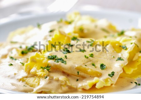Ravioli with cream - stock photo