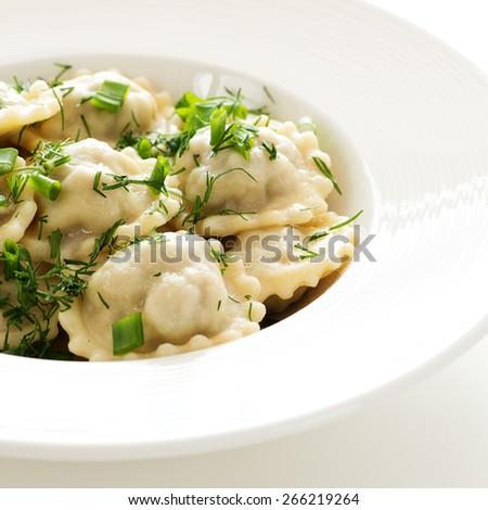 Ravioli with greens - stock photo