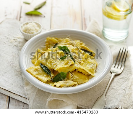 Ravioli with sage butter sprinkled with grana padano cheese