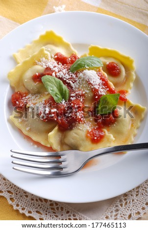ravioli with tomato sauce and cheese garnished with basil