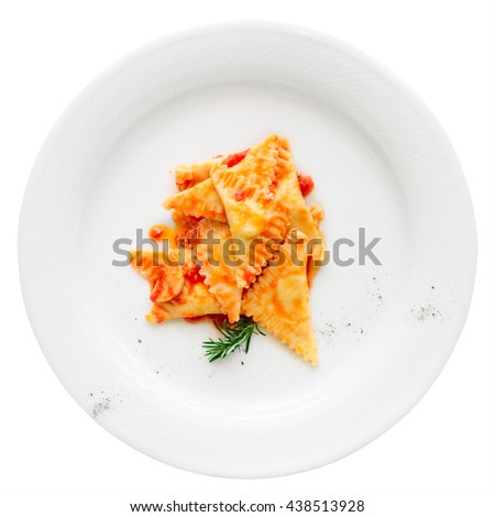 Ravioli with tomato sauce and herbs isolated on white background - stock photo
