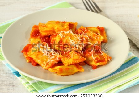 Ravioli with tomato sauce and parmesan  - stock photo