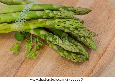 Raw asparagus heap on the wood background - stock photo