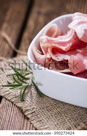 Raw Bacon slices (detailed close-up shot) on vintage wooden background - stock photo