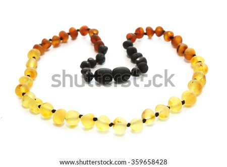 Raw baltic amber baby teething necklace isolated on white