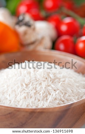 Raw basmati rice with vegetable, selective focus - stock photo