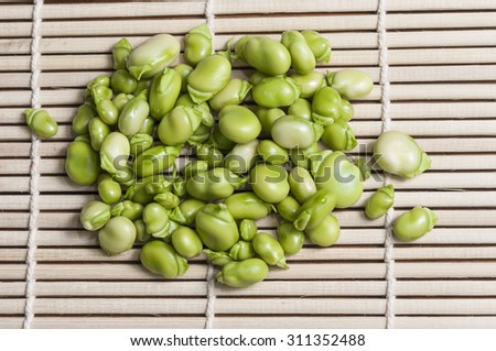 Raw beans on a tablecloth raffia