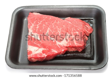 Raw beef in supermarket black foam tray on white background