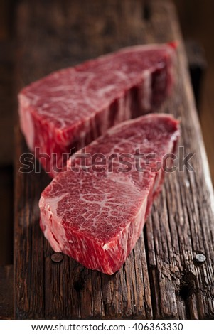 raw beef marbled steak with vintage  old wooden background