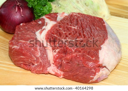 Raw beef meat and vegetables as background